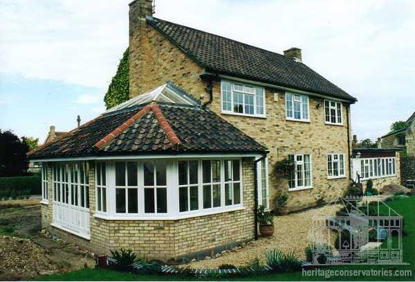A lounge extension was required with a pan tiled roof but with a bit more style and pizzaz than a convential extension